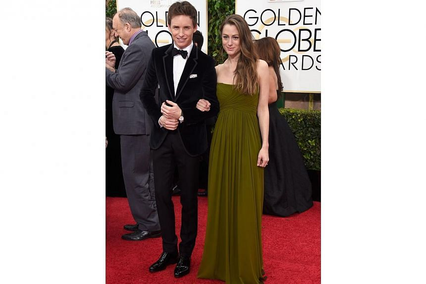 The Theory Of Everything star Eddie Redmayne and wife Hannah Bagshawe at the 72nd Annual Golden Globe Awards on Jan 11, 2015, in Beverly Hills, California. -- PHOTO: AFP