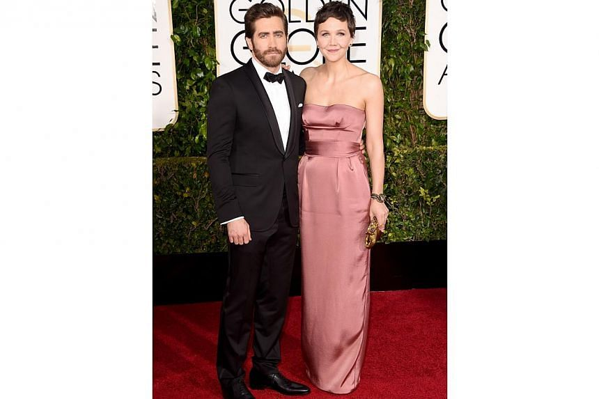 Actor Jake Gyllenhaal and his sister, actress Maggie Gyllenhaal, at the 72nd Golden Globe Awards on Jan 11, 2015. -- PHOTO: AFP