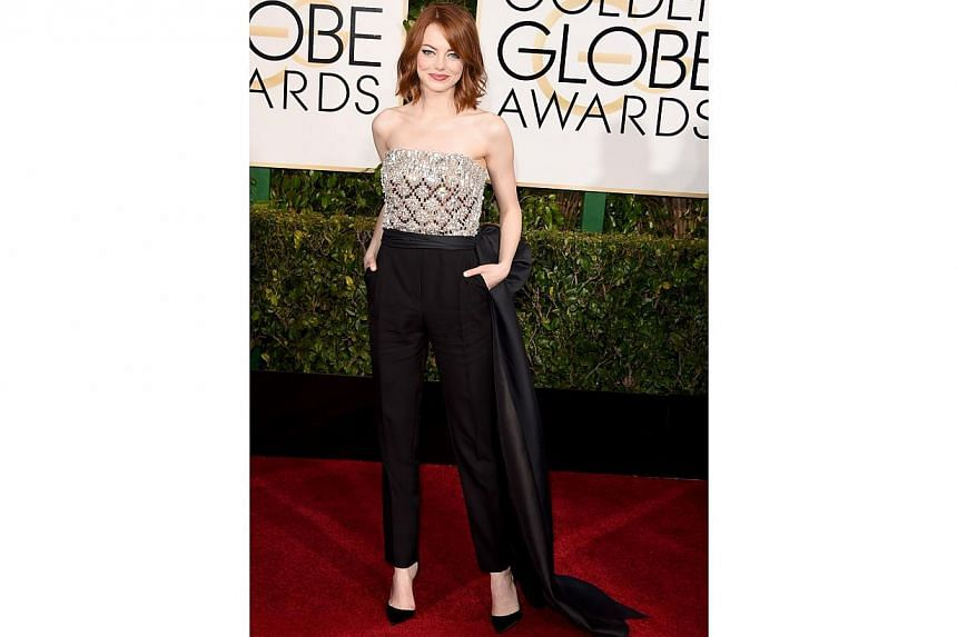 Emma Stone, nominated for her role in Birdman, attending the 72nd Annual Golden Globe Awards at the Beverly Hilton Hotel on Jan 11, 2015, in Beverly Hills, California. -- PHOTO: AFP