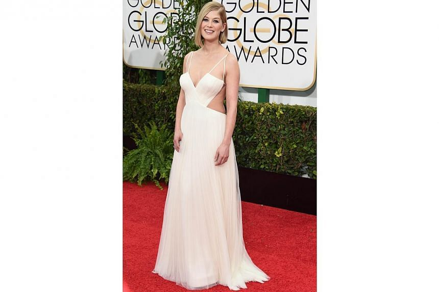 Actress Rosamund Pike, nominated for her turn as Amy Dunne in Gone Girl, at the 72nd Annual Golden Globe Awards on Jan 11, 2015, in Beverly Hills, California. -- PHOTO: AFP