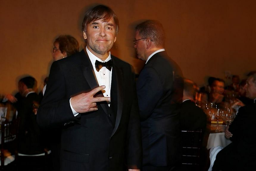 Richard Linklater wins Golden Globe award for best director for his film Boyhood. -- PHOTO: REUTERS