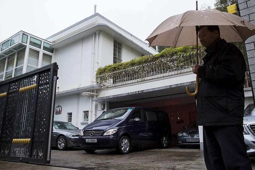 A security standing guard outside the house of Hong Kong media tycoon Jimmy Lai in Hong Kong on Jan 12, 2015. The home and former offices of Mr Lai, an outspoken critic of Beijing who also played a prominent role in large pro-democracy protests last