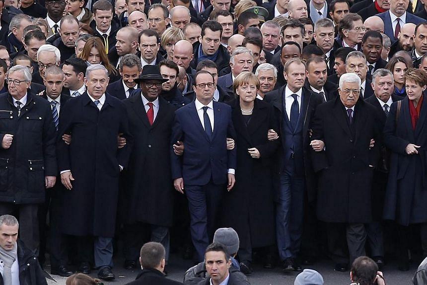 World leaders including (from left) EU Commission Jean Claude Juncker, Israeli Prime Minister Benjamin Netanyahu, Mali's President Ibrahim Boubacar Keita, French President Francois Hollande, German Chancellor Angela Merkel, President of the European