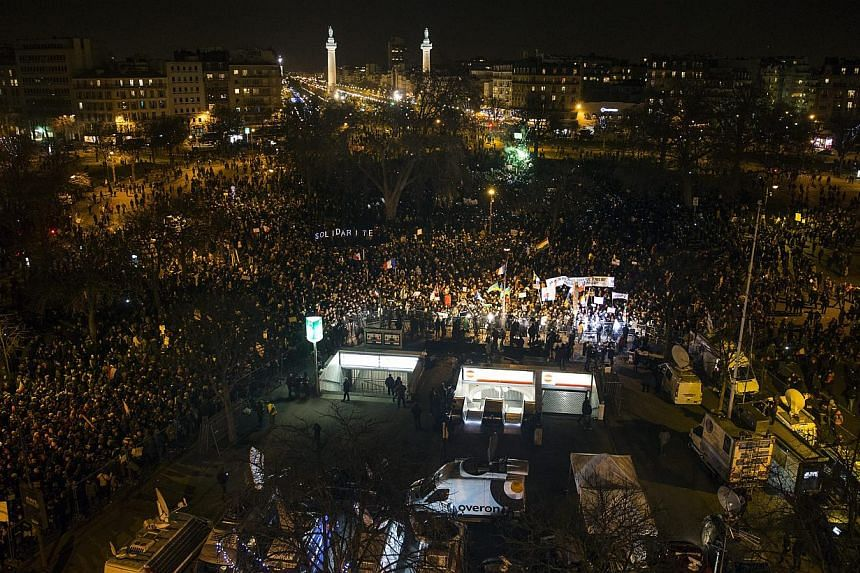 Thousands gathering at the Place de la Nation finishing point of a march to honour the victims of the terrorist attacks. -- PHOTO: EPA