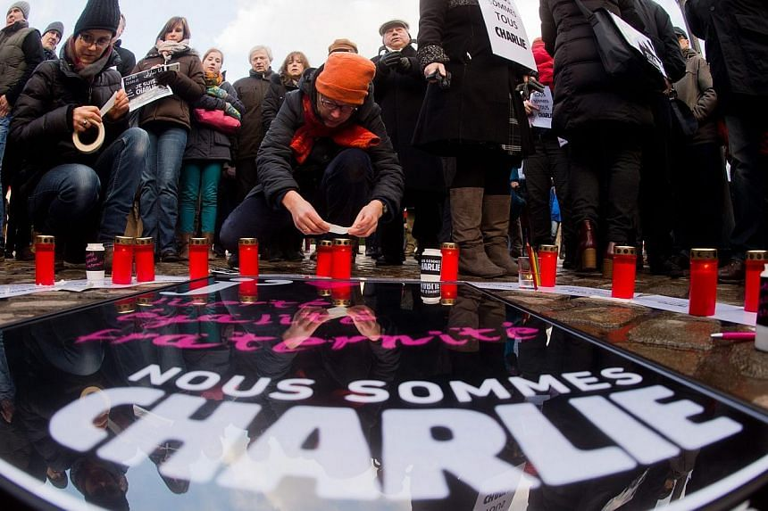 People gathering to express solidarity for the victims of the attack on the French satirical magazine 'Charlie Hebdo' on the Opernplace in Hanover, Germany, on Jan 11,2015. -- PHOTO: EPA