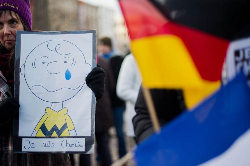 A woman at a rally in Hanover, central Germany. -- PHOTO: AFP