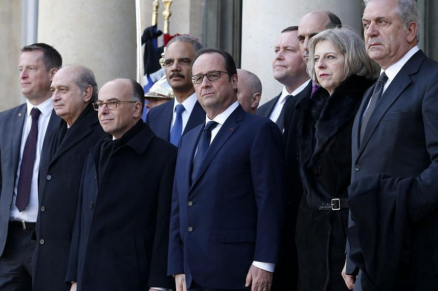 French President Francois Hollande (centre) welcomes the Interior Ministers Jorge Fernandez Diaz of Spain (second from left), Bernard Cazeneuve of France (third from left), and US Attorney General Eric Holder (fourth from left), British Home Se