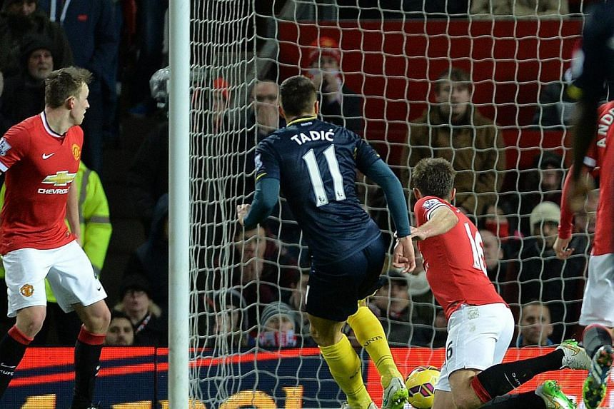 Southampton's Dusan Tadic (centre) scores the opening goal, and only goal, as his team beat Manchester United and Southampton at the Old Trafford in Manchester on Sunday. -- PHOTO: EPA