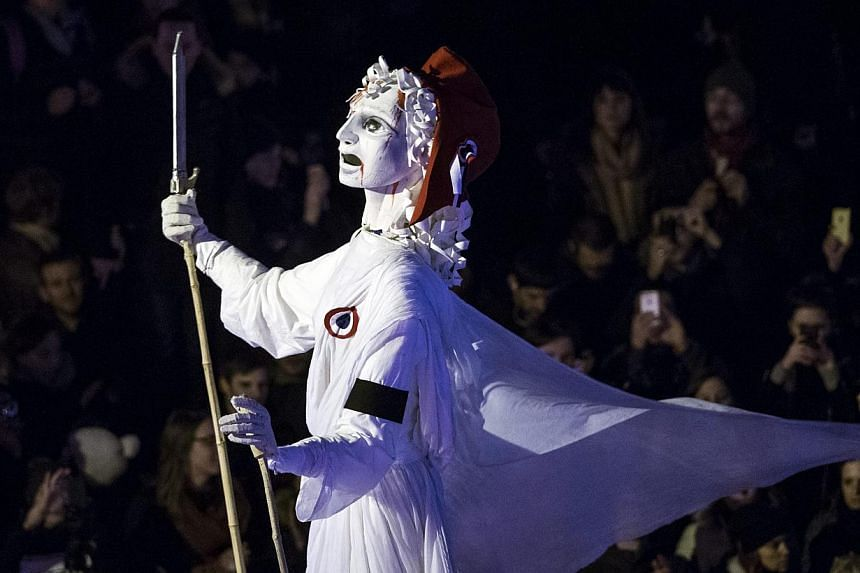 A giant Marianne, the national symbol of France, arrives at the Place de la Nation finishing point of the march to honour the victims of the terrorist attacks and to show unity, in Paris, France on Sunday. -- PHOTO: EPA