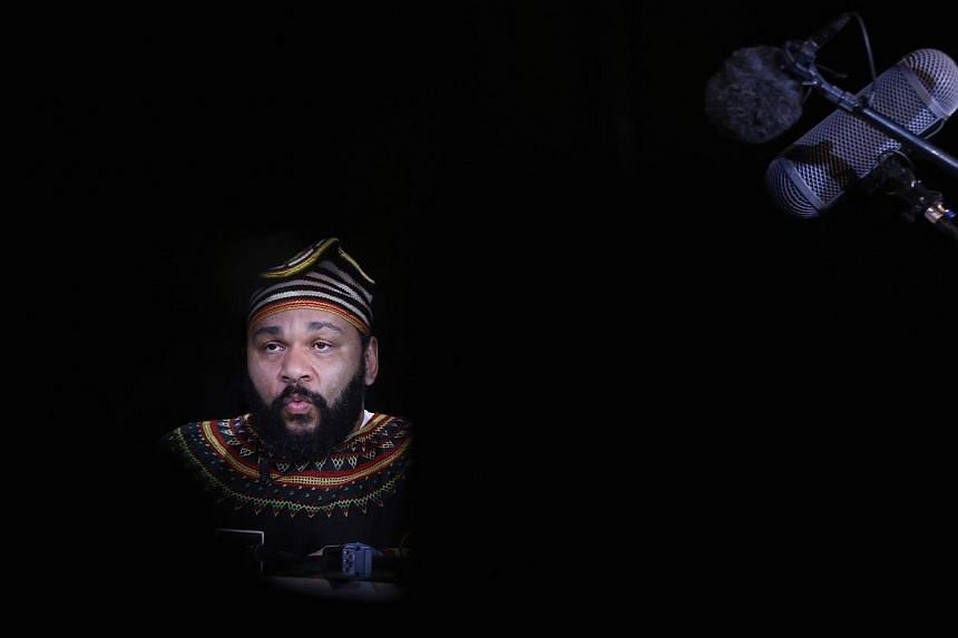 """French comedian Dieudonne M'Bala M'Bala, also known as just """"Dieudonne"""", attends a news conference at the Theatre de la Main d'or in Paris, in this photo taken in January last year. 2014 file photo. -- PHOTO:REUTERS"""