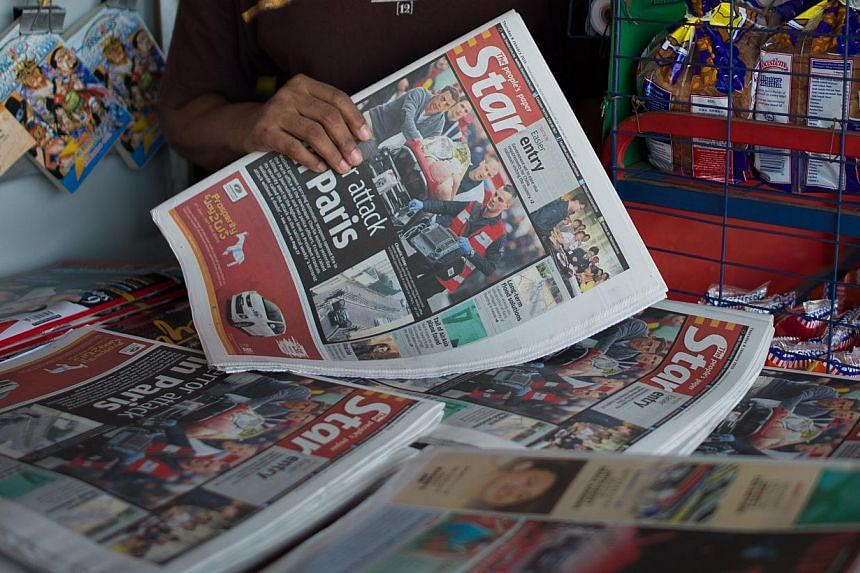 The Star newspaper on sale at a shop in Kuala Lumpur on Jan 8, 2015, after the Jan 7 attack on French satirical weekly Charlie Hebdo in Paris. -- PHOTO: AFP