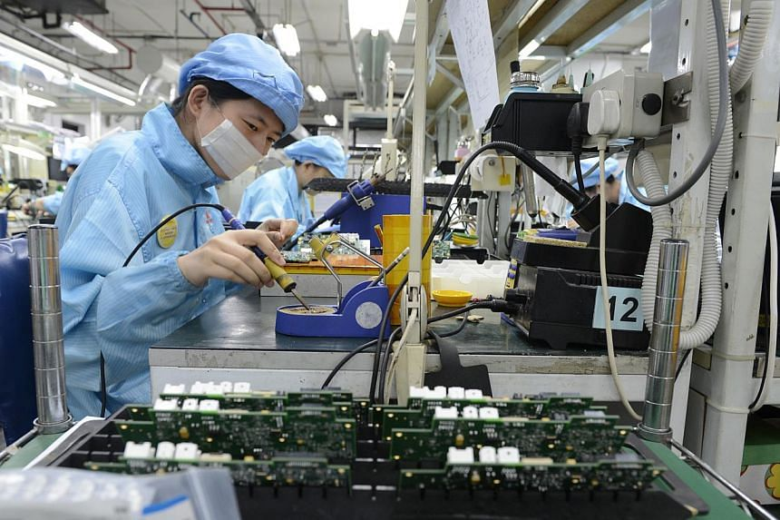 Eight firms, which were not named, shut down their manufacturing operations last year and moved to Malaysia, China and Thailand. -- ST PHOTO: DESMOND FOO