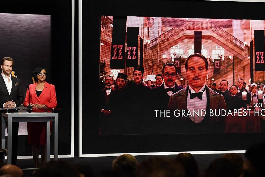 Hosts Chris Pine and Academy president Cheryl Boone announcing the movie 'The Grand Budapest Hotel' as one of the Oscar nominees for Best Picture. -- PHOTO: AFP