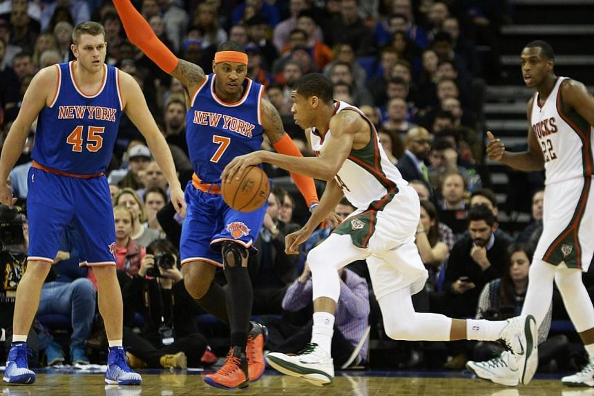 Giannis Antetokounmpo from Milwaukee Bucks (2nd from right) competes for the ball against Carmelo Anthony of the New York Knicks (2nd from left) during an NBA game at the O2 Arena in London, Britain on Jan 15, 2015. -- PHOTO: EPA