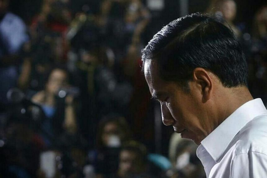 Indonesia's new president, Joko Widodo, is facing mounting pressure to replace his sole pick for national police chief after the anti-graft agency declared the nominee a corruption suspect. -- ST PHOTO: KEVIN LIM