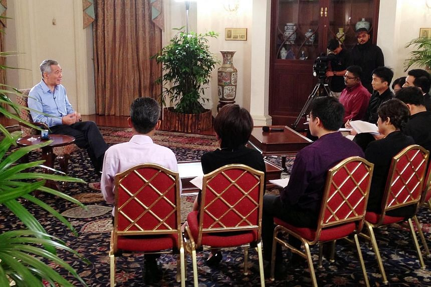 Interview with Prime Minister Lee Hsien Loong at the Istana on Jan 14, 2015. -- ST PHOTO:ALPHONSUS CHERN