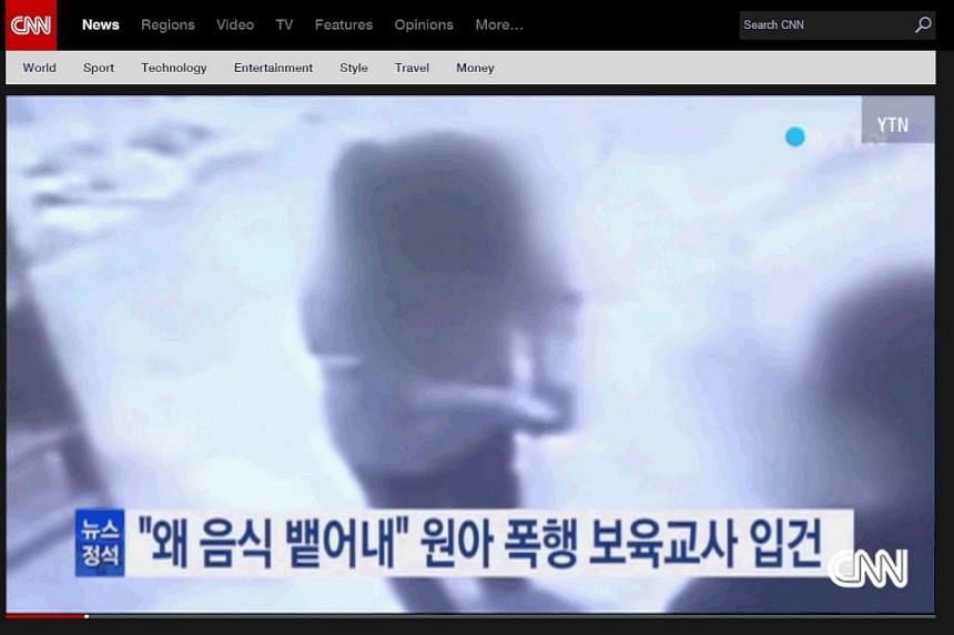 A toddler being hit by a teacher in a South Korean nursery is caught on camera, causing nationwide outrage. -- PHOTO: SCREENGRAB FROM CNN.COM