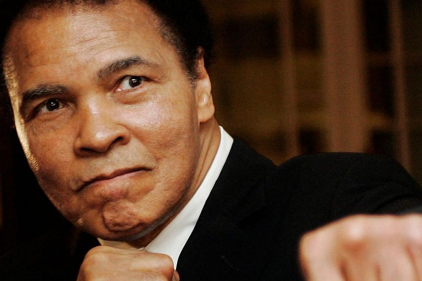 US boxing great Muhammad Ali at the Crystal Award ceremony at the World Economic Forum (WEF) in Davos, Switzerland, in 2006. -- PHOTO: REUTERS