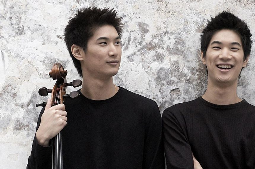 Twin cellists Ng Pei-Jee and Ng Pei-Sian will take the spotlight in prominent Finnish composer Kalevi Aho's Concerto For Two Cellos And Orchestra. -- PHOTO: SINGAPORE SYMPHONY ORCHESTRA