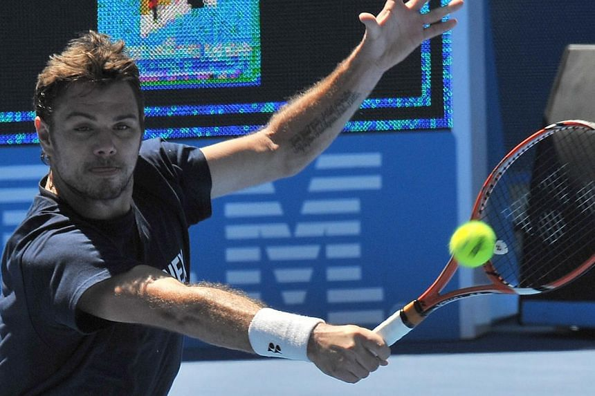Stan Wawrinka of Switzerland hits a return during a training session ahead of the Australian Open tennis tournament in Melbourne on Jan 16, 2015. The defending champion was on Friday pitted in the top half of the draw at the Australian Open with Nova