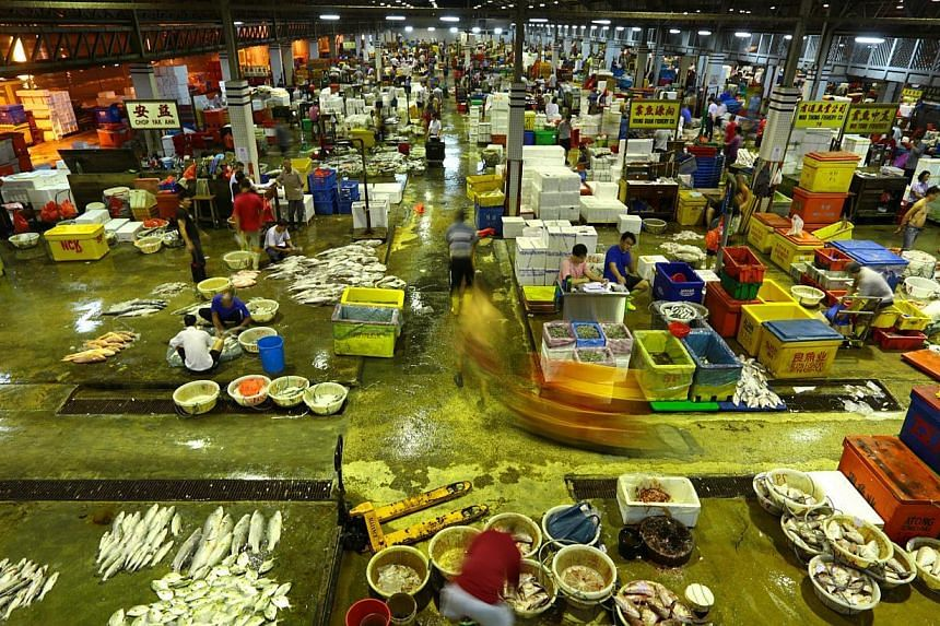 The wholesale fish market at the Jurong Fishery Port, where 250 tonnes of seafood is sold every day. -- PHOTO: THE NEW PAPER