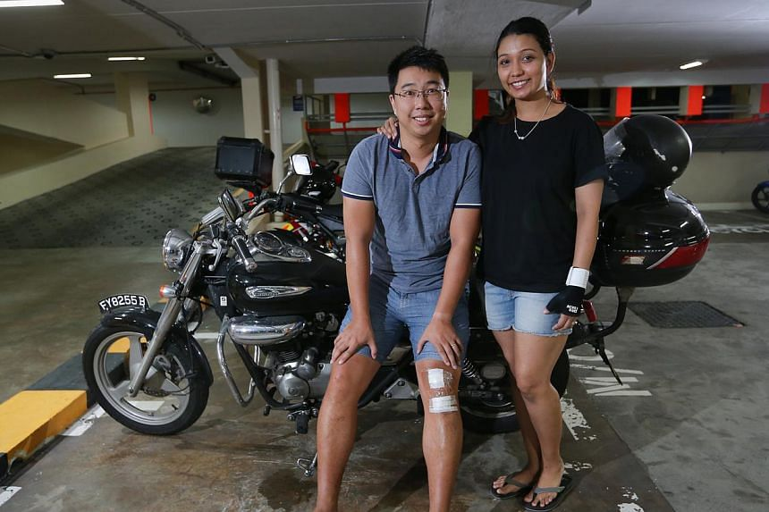 Mr Kun Wai Kit, 31, and Ms Shan Gomes, 30, escaped serious injury when their motorcycle skidded over the oil patch. They stayed to warn oncoming motorists of the danger before an LTA officer arrived on the scene.