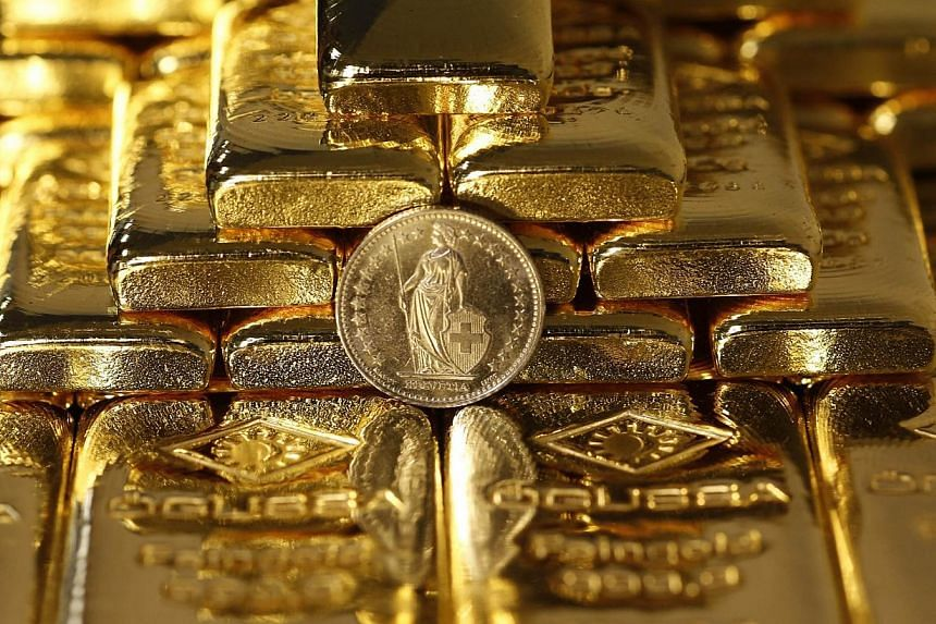 The Swiss central bank's surprise move to abandon the franc's cap against the euro sent investors rushing to gold as a haven from swings in currencies. -- PHOTO: REUTERS