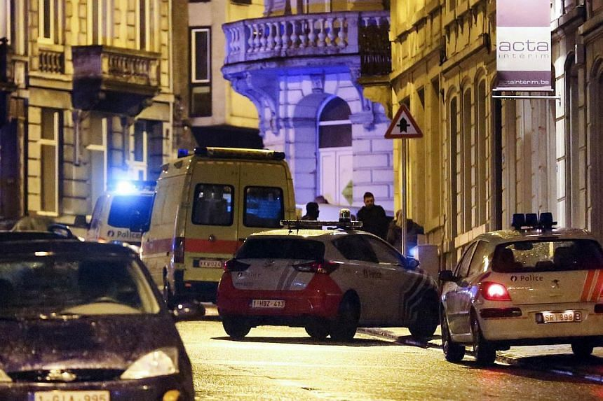 Police cars and vans are parked in a street as police set up a large security perimeter in the city center of Verviers, eastern Belgium, where two people were killed in an anti-terrorism operation on Jan 15, 2015. -- PHOTO: AFP