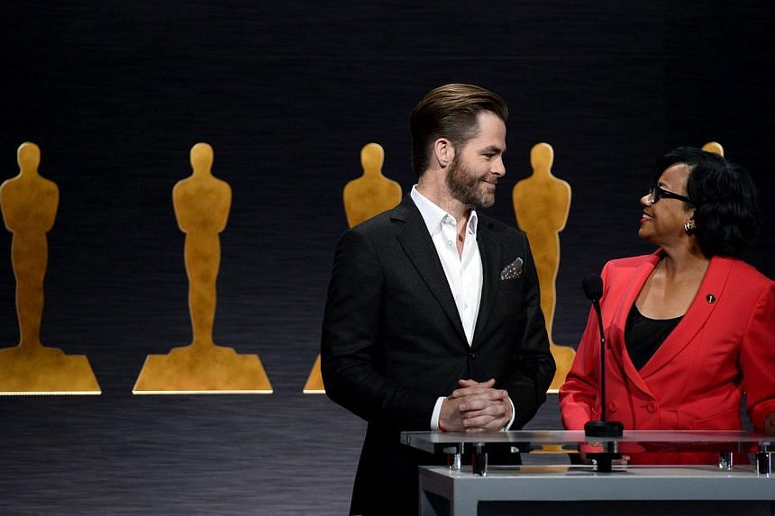 Actor Chris Pine (left) and academy president Cheryl Boone Isaacs share a moment as they announce the nominations for the 87th Academy Awards in Beverly Hills, California, on Jan 15, 2015. -- PHOTO: EPA