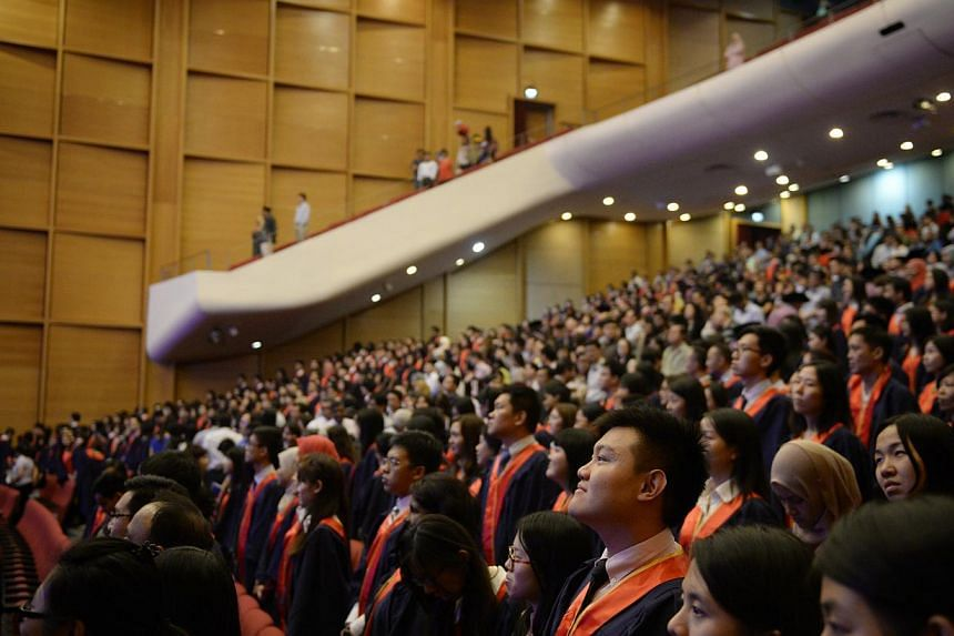 Graduants at the National Institute of Education (NIE) Teachers' Investiture Ceremony pictured after singing the national anthem on Jan 16, 2015. -- ST PHOTO: MARK CHEONG
