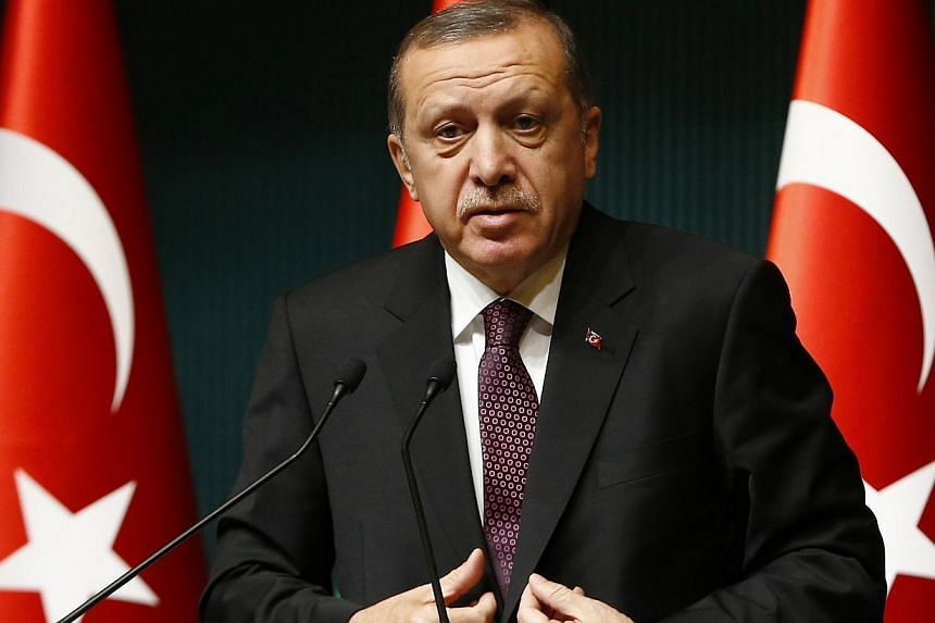 "Turkish President Recep Tayyip Erdogan (above) on Friday lashed out at Charlie Hebdo for its ""provocative"" publications about Islam, saying the French satirical weekly incited hatred and racism. -- PHOTO: REUTERS"