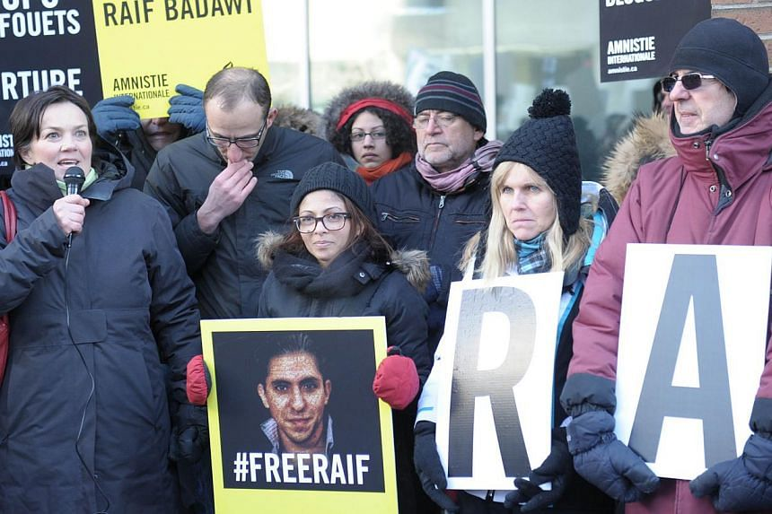 Ensaf Haidar (centre), the wife of Saudi blogger Raef Badawi, holds a vigil in Montreal, Quebec on Jan 13, 2015 urging Saudi Arabia to free her husband who was flogged in public Jan 9, 2015 near a mosque in the Red Sea city of Jeddah, receiving 50 la