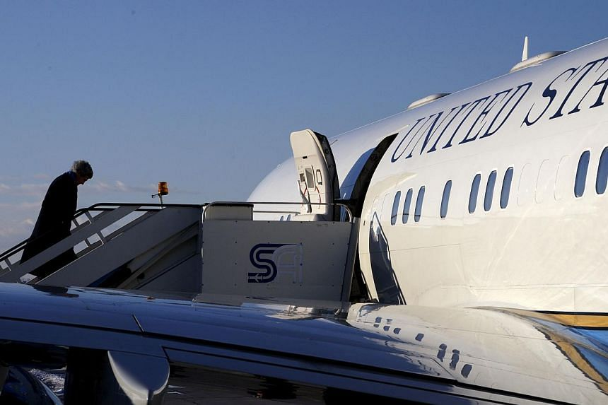 US Secretary of State John Kerry boards his plane in Sofia for a flight to Paris on Jan 15, 2015. -- PHOTO: REUTERS