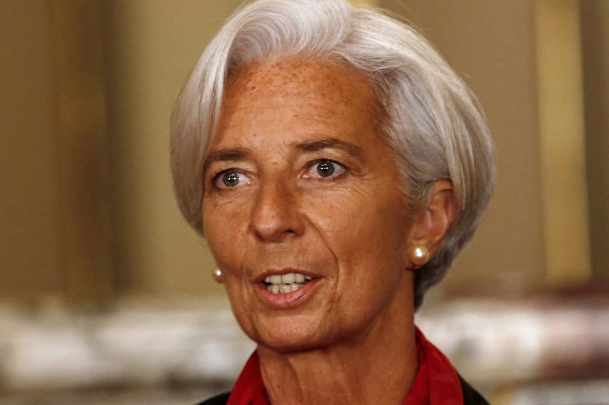 IMF chief Christine Lagarde (above) on Thursday encouraged the European Central Bank to unleash fresh stimulus on the ailing euro zone, saying falling global oil prices increase the risk of deflation.-- PHOTO: REUTERS