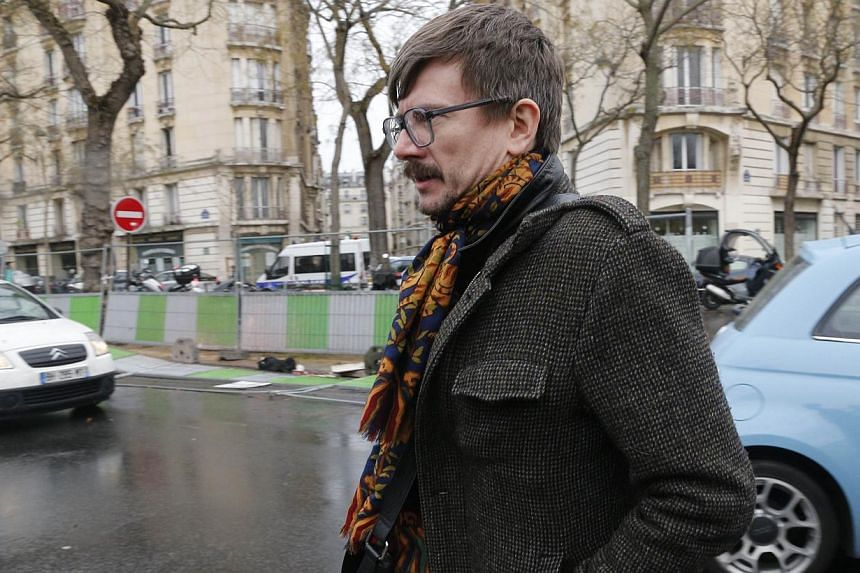 French cartoonist Renald Luzier, aka Luz, arrives to attend the funeral of Elsa Cayat, a psychoanalyst and contributor at the French satirical weekly Charlie Hebdo, on Jan 15, 2015 at the Montparnasse cemetery in Paris. -- PHOTO: AFP