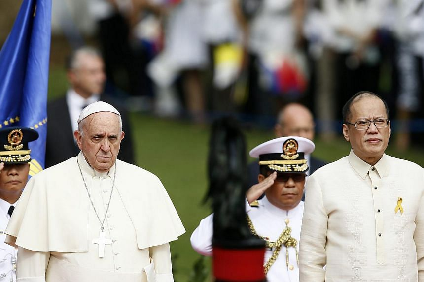 Pope Francis being escorted by Philippine President Benigno Aquino III during the arrival ceremony at Malacanang presidential palace in Manila, Philippines, on Jan 16 2015. -- PHOTO: EPA