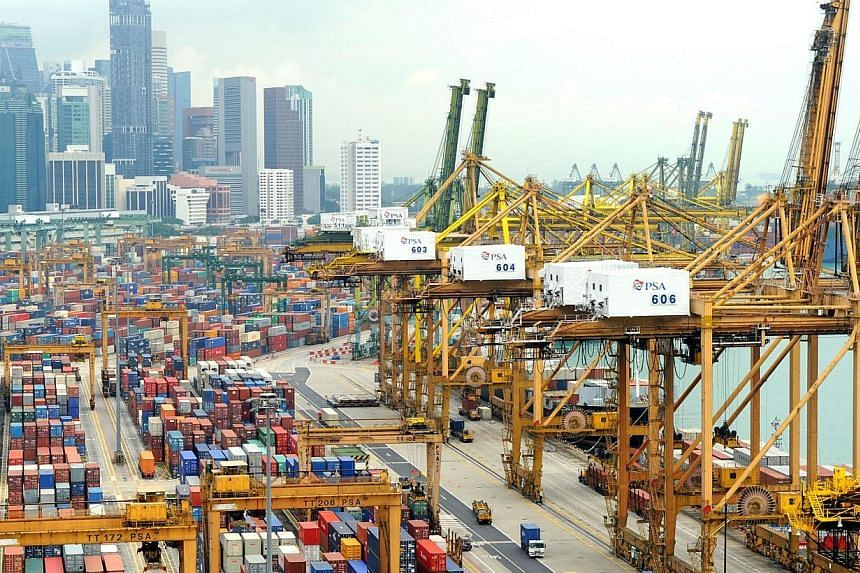 The maritime industry can be cautiously optimistic about this year's outlook with lower fuel costs as ports here hit another high in handling containers. -- ST PHOTO: TIFFANY GOH