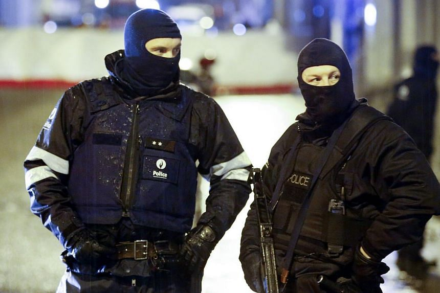 Riot police block the Rue de la Colline in Verviers, Belgium, Jan 15 2015, during an anti-terrorist operation. Two people have died and one was injured in a police anti-terrorism operation in the eastern Belgian city of Verviers against a suspected m