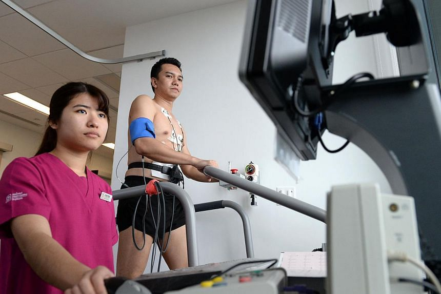 Housed within the recently-opened National Heart Centre Singapore l, the SAF heart screening centre will share state-of-art heart screening technology and have access to the Republic's leading cardiologists. -- ST PHOTO: DESMOND FOO