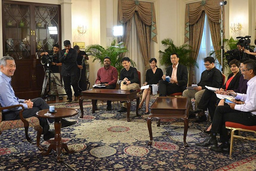 Prime Minister Lee Hsien Loong (left) during an interview with Singapore media at the Istana on Jan 14, 2015. -- ST PHOTO: ALPHONSUS CHERN