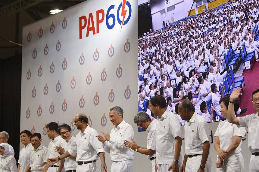 Prime Minister Lee Hsien Loong, who is also the People's Action Party's secretary-general, with other members of the PAP's new central executive committee at the PAP60 Rally on Dec 7, 2014. -- ST PHOTO: MARK CHEONG