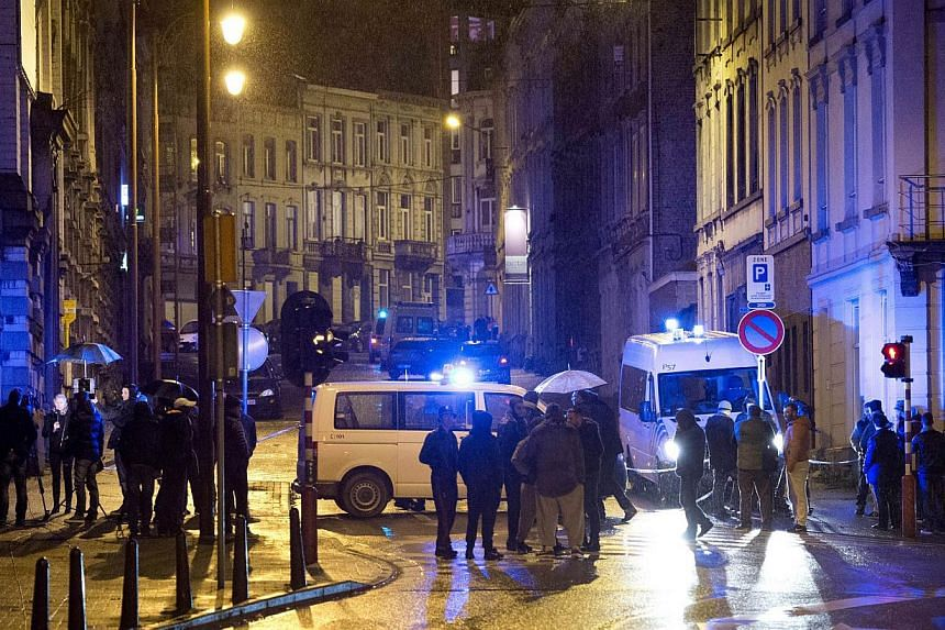 """Police block Colline street in Verviers, eastern Belgium, on Jan 15, 2015, after two were killed during an anti-terrorist operation. Belgian police launched a """"jihadist-related"""" anti-terrorism operation in the eastern town of Verviers on Jan 15. -- P"""