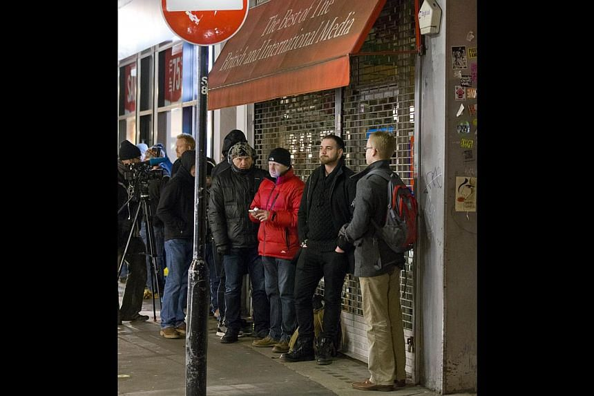 People queuing to buy a copy of the satirical magazine Charlie Hebdo. The Paris attacks illustrate how dangerously close we are to a world in which each terrorist gets one free strike. -- PHOTO: AGENCE FRANCE-PRESSE