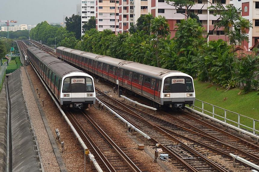 MRT trains travelling on tracks. The Land Transport Authority (LTA) is taking steps to make it harder for intruders to gain access to train tracks via anti-climb barriers topped with razor blades. -- ST PHOTO: ALPHONSUS CHERN