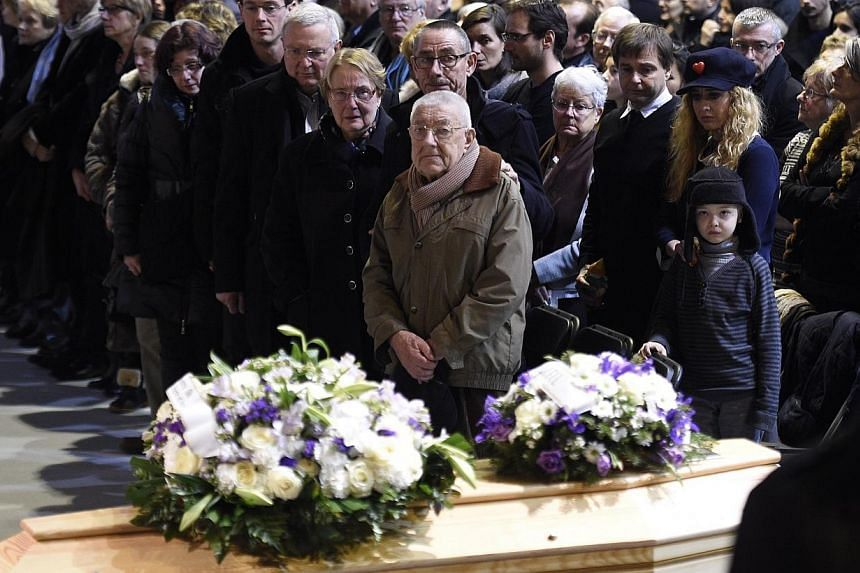 People attend the funeral ceremony of French cartoonist and Charlie Hebdo editor Stephane 'Charb' Charbonnier, in Pontoise, outside Paris, France, on Jan 16 2015. Almost half of French oppose publication of cartoons depicting Islam's Prophet Muh