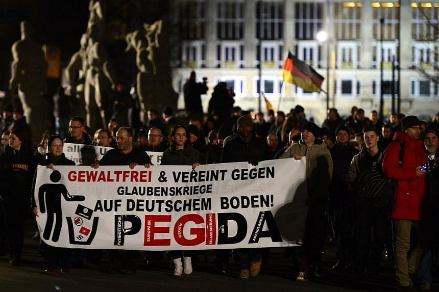 A picture taken on Jan 12, 2015 shows sympathizers of German right-wing populist movement Pegida (Patriotic Europeans Against the Islamisation of the Occident) attending their twelfth march in Dresden, eastern Germany. Germany's anti-Islamic Peg