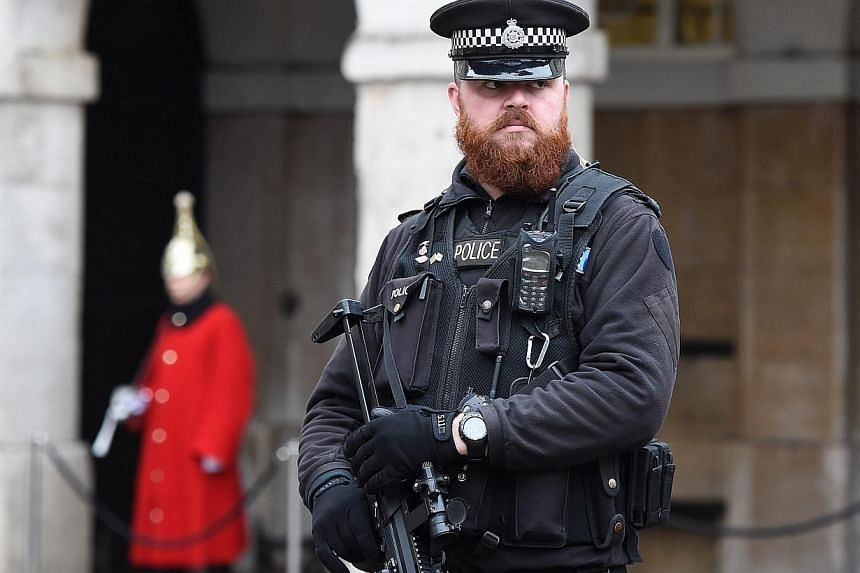 """An armed policeman standing guard at Downing Street in London, Britain, on Jan 12, 2015.Britain's ability to prevent terrorist attacks is hampered by outdated laws that are """"no longer fit for purpose"""", a former MI5 chief said in an interview pu"""