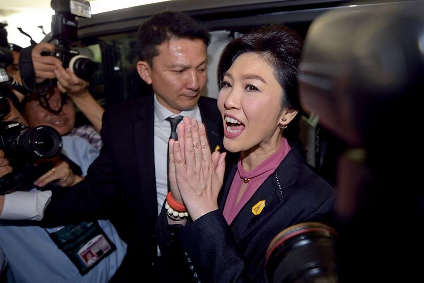 Four senior members of the former government of ousted prime minister Yingluck Shinawatra have defended her on social media over a controversial rice buying scheme after she failed to appear at her second impeachment hearing on Friday, Jan 16, 2015.