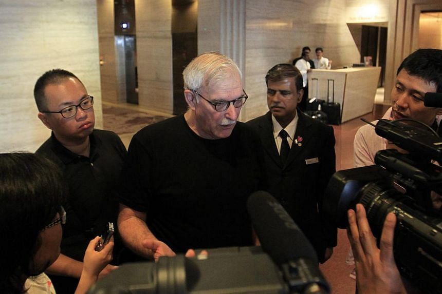 Leon Sigal (centre) , Director of the Northeast Asia Cooperative Security Project at the Social Science Research Council, speaking to reporters at a hotel lobby in SIngapore on Jan 18, 2015.North Korean nuclear negotiators met former United Sta
