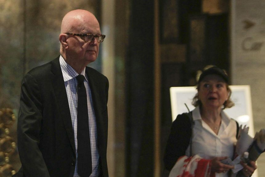 Former US envoy for North Korea policy Stephen Bosworth and an unidentified woman walk through a hotel lobby in SIngapore on Jan 18, 2015, during talks with North Korean nuclear negotiators. -- PHOTO: EPA
